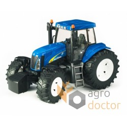 Игрушка - трактор New Holland T8040
